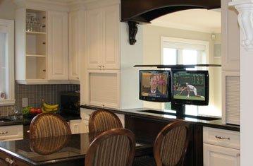 Dual Hidden TVs in Dining Room