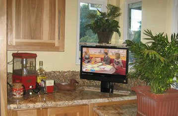 Hidden TV Pops Up from Granite Countertop