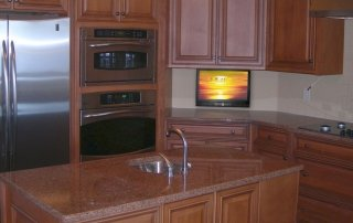 Small TV Drops Down from Kitchen Cabinet