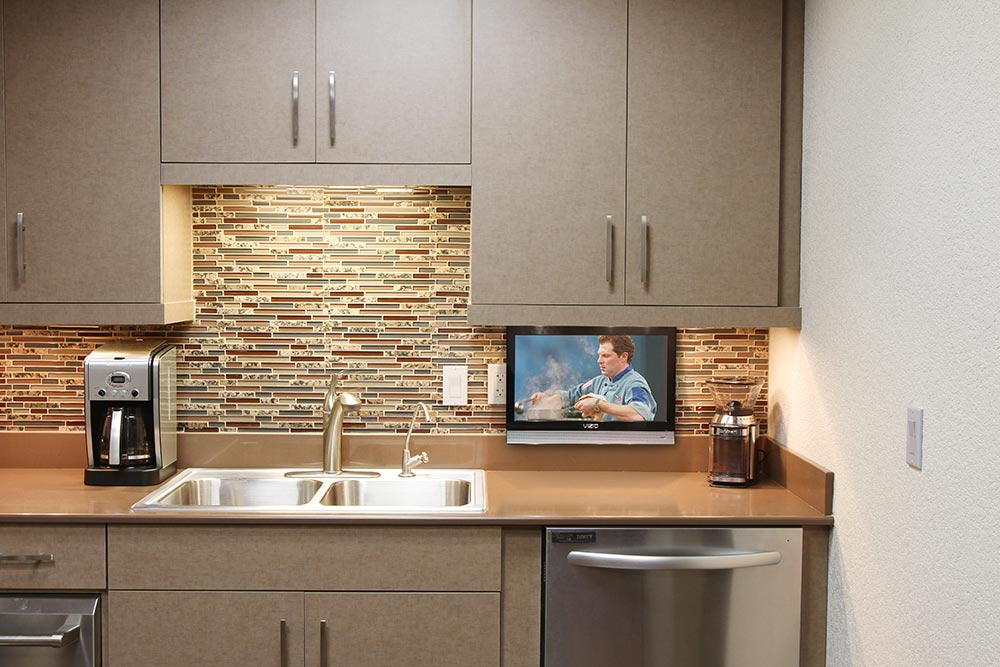 Subcompact drop down tv lift nexus 21 tv lifts for Television in the kitchen ideas