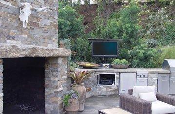 Custom Outdoor Kitchen with Hidden TV