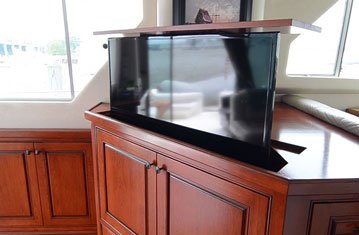 Hidden TV Lift Complements Gorgeous Boat Interior
