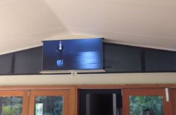 TV Drops Down Seamlessly From Ceiling