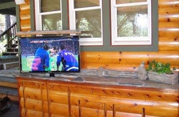 Pop Up TV Outside Mountain Cabin
