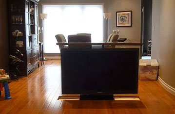 Under Floor Pop Up Tv Separates Dining and Living Room